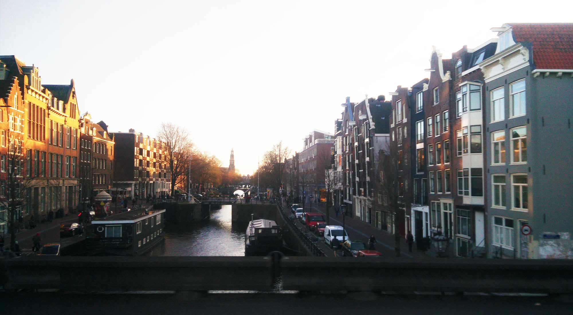 a canal in Amsterdam at sunset