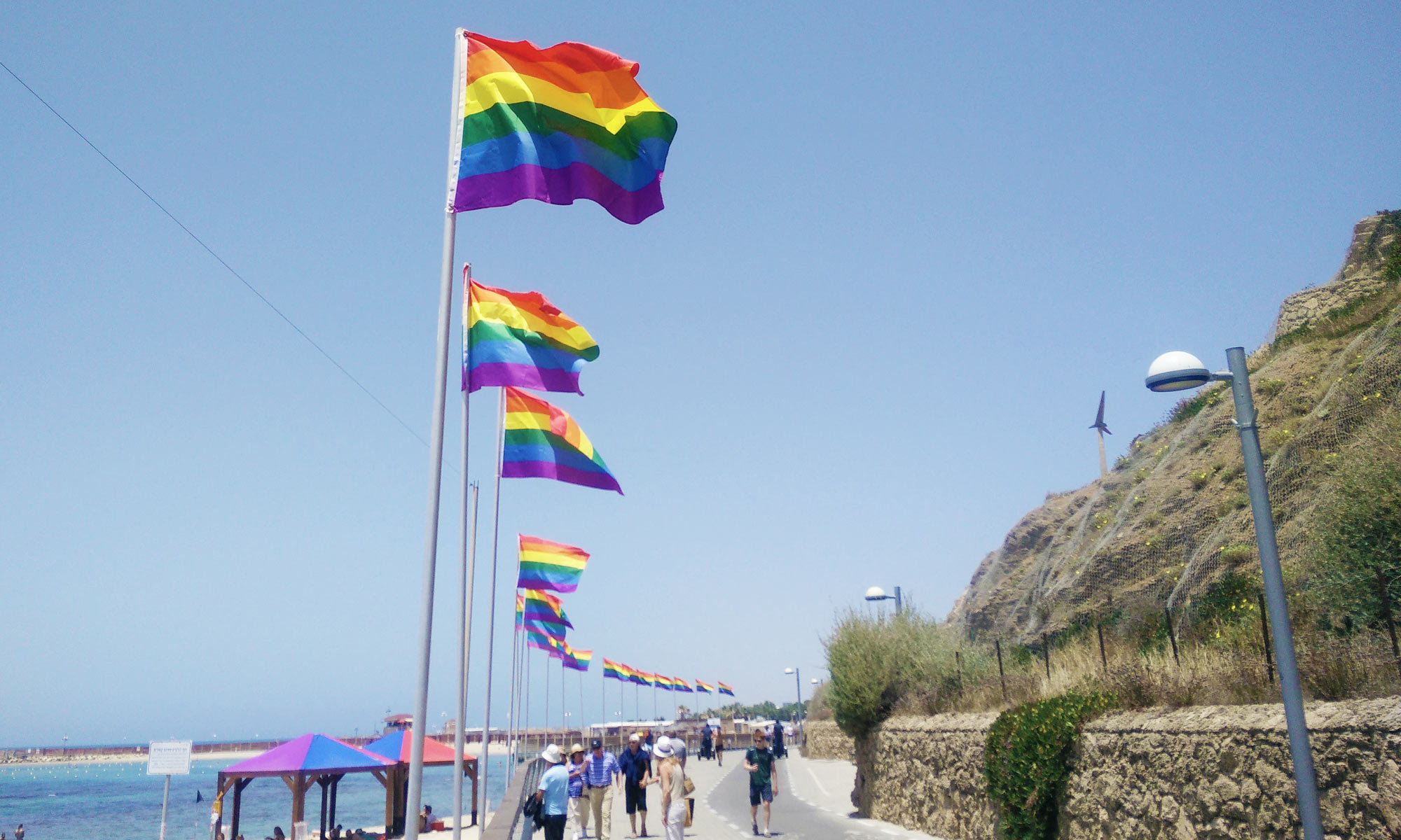 rainbow flags at the gay beach called Hilton Beach in Tel Aviv