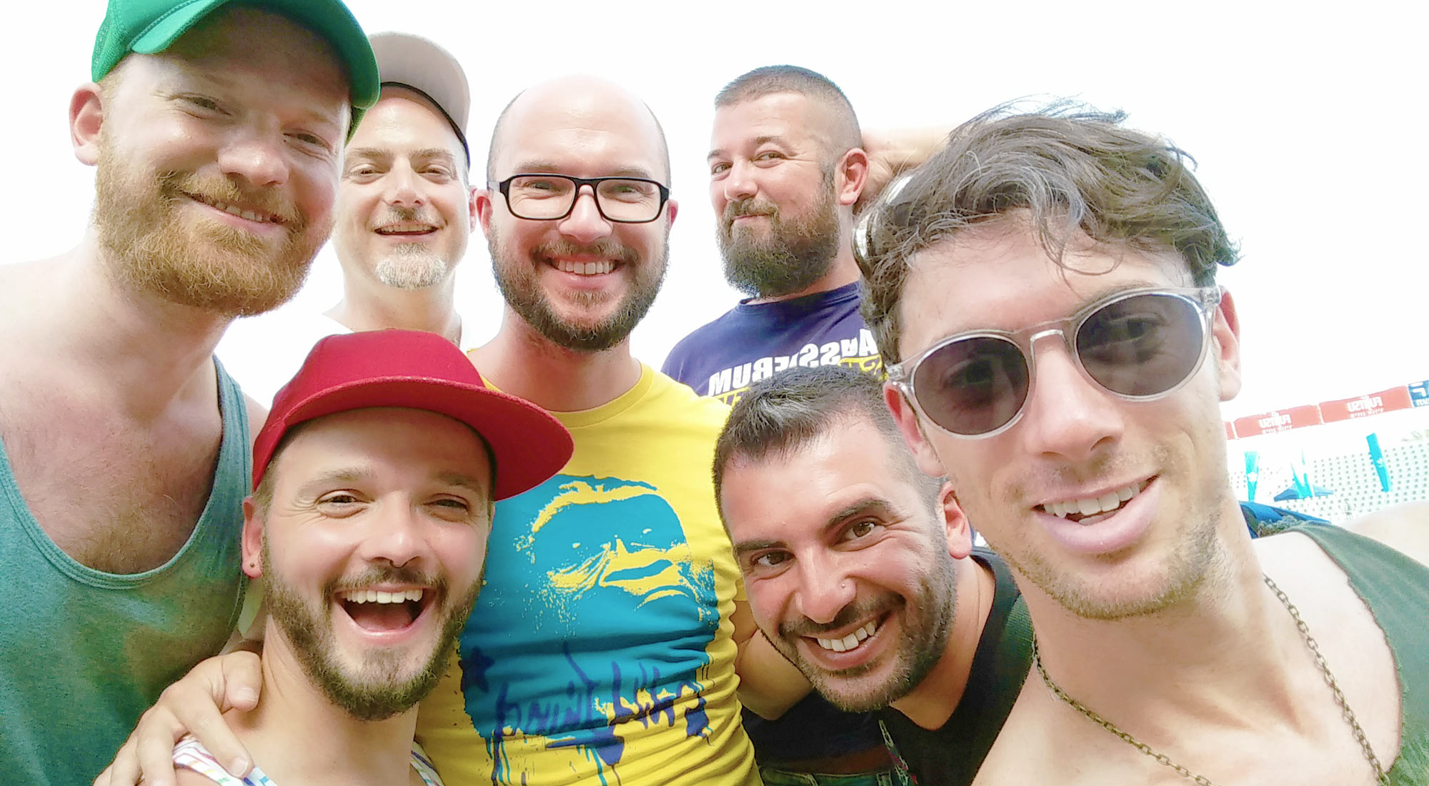 Selfie of several gay travel bloggers: Couple of Men, Martin Wolkner (out scouting), Troy Petenbrink, Carlos Vidal, Gian Luca Sgaggero and Dan Tracer at the open-air party with DJ Offer Nissim at Bloomfield Stadium for Tel Aviv Pride 2016